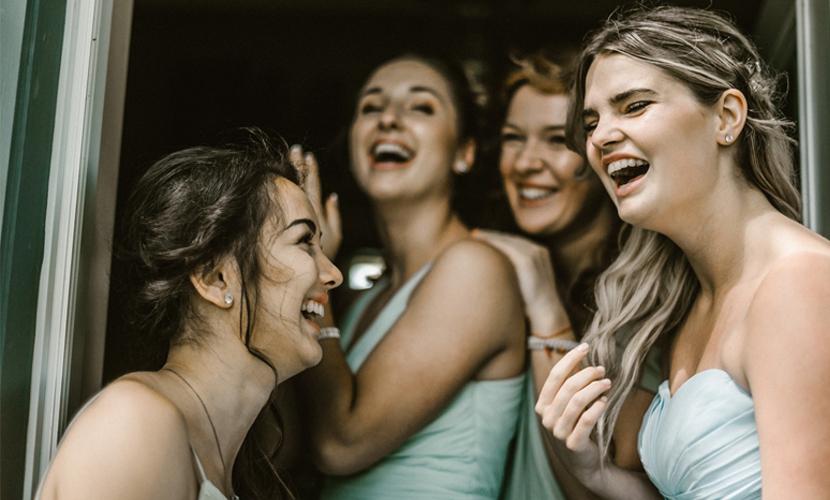 Bridesmaid Etiquette - Bridesmaids Laughing In Light Blue Dresses