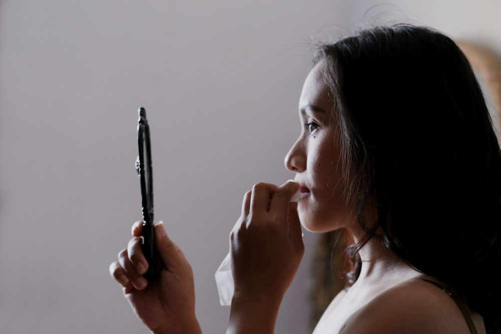 Bridal Makeup Artist - Woman Dabbing Lipstick and Holding a Mirror