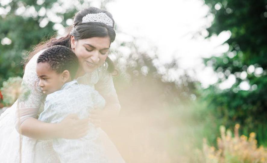 Adults Only Wedding - Bride Hugging A Little Boy
