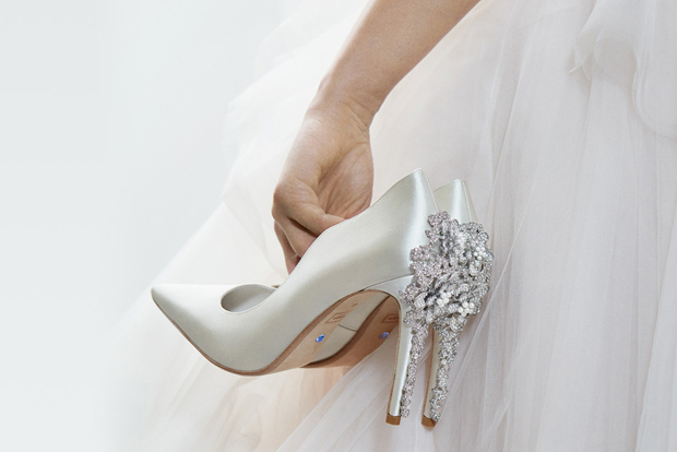 Wedding Shoes - Bride Carrying A Pair of Embellished High Heels