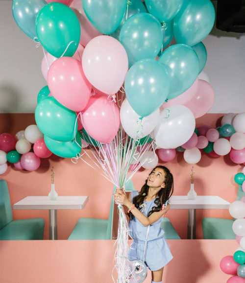 Party Photographer - Girl Holding Colorful Balloons