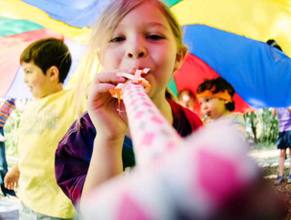 Party Photographer - Girl with Noisemaker