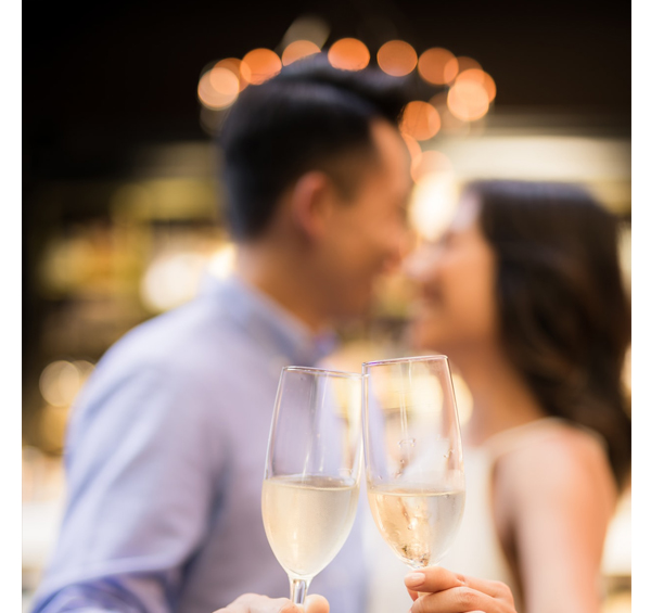 Engagement Party - Couple Holding Champagne Glasses