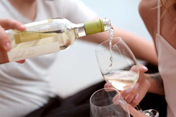 Engagement Party - Pouring White Wine Into Glass