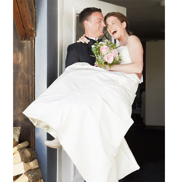 Wedding Traditions Disappearing - Groom Carrying Bride Over Threshold