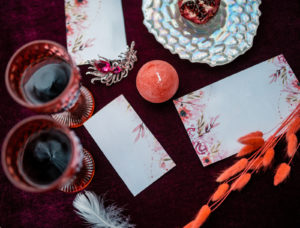 Red wine with red wedding themed cards.